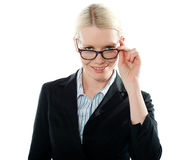 Businesswoman holding her glasses. And taking a closer look from within Royalty Free Stock Images