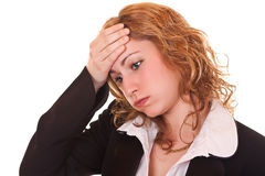 Businesswoman holding her head Royalty Free Stock Photo