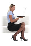 Businesswoman holding her laptop Stock Image