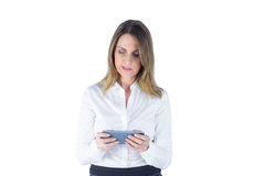 Businesswoman holding her mobile phone Stock Image