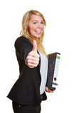 Businesswoman holding her thumbs up Royalty Free Stock Photography