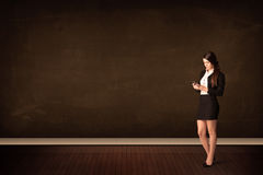 Businesswoman holding high tech tablet on background with copysp Stock Image
