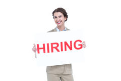 Businesswoman holding a hiring sign Royalty Free Stock Photo