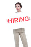 Businesswoman holding a hiring sign Royalty Free Stock Images
