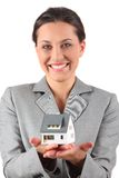Businesswoman holding home Stock Image