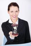 Businesswoman holding hourglass. Pretty caucasian businesswoman holding hourglass Royalty Free Stock Photos