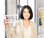 Businesswoman holding hourglass Royalty Free Stock Image