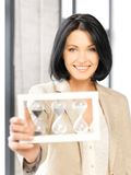 Businesswoman holding hourglass. Picture of attractive businesswoman holding hourglass Royalty Free Stock Photos