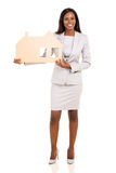 Businesswoman holding house Royalty Free Stock Image
