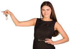 Businesswoman holding house key Royalty Free Stock Photography