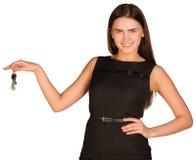 Businesswoman holding house keys Stock Photography