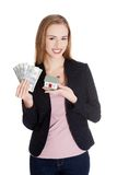 Businesswoman holding house model and dollar bills Royalty Free Stock Images