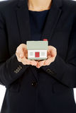 Businesswoman holding house model. Royalty Free Stock Image
