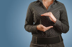 Businesswoman holding imaginary idea in hands - la Stock Photos