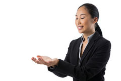 Businesswoman holding invisible object Stock Photo