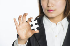 Businesswoman Holding Jigsaw Puzzle Stock Photography