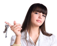 Businesswoman holding keys Royalty Free Stock Photo