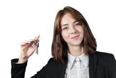 Businesswoman holding the keys in her hand. Portrait of businesswoman holding the keys in her hand isolated on white Stock Photo
