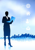 Businesswoman holding laptop Stock Photography