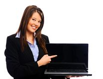 Businesswoman holding laptop Stock Photography