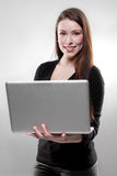Businesswoman holding a laptop Stock Photo