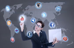 Businesswoman holding laptop click on social network Royalty Free Stock Images