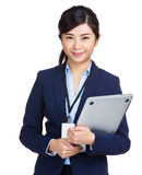 Businesswoman holding laptop computer Stock Photography