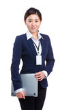 Businesswoman holding laptop Stock Image