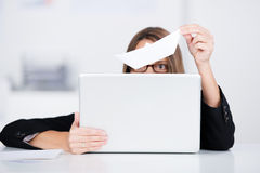 Businesswoman Holding Laptop And Paperboat Representing Loss Royalty Free Stock Images