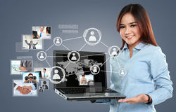 Businesswoman holding a laptop pc and surfing in the social netw Stock Images