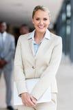 Businesswoman holding laptop Stock Photos