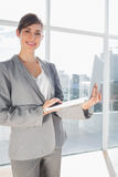 Businesswoman holding laptop and smiling Stock Photography