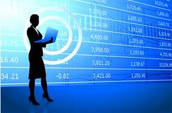 Businesswoman holding laptop on stock market Royalty Free Stock Photo