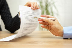 Businesswoman holding legal document and  wants an explaination Stock Images