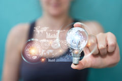 Businesswoman holding a lighbulb with connections in her hand Stock Photos