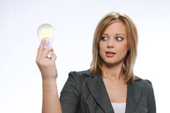 Businesswoman holding a light bulb Stock Images