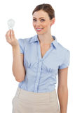 Businesswoman holding a light bulb Royalty Free Stock Photography