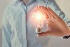 Businesswoman holding light bulb, innovation and inspiration con. Cept royalty free stock photos