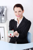 Businesswoman holding little house. Royalty Free Stock Photo