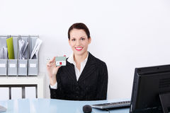 Businesswoman holding little house. Stock Image