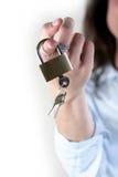 Businesswoman holding lock. Businesswoman holding the lock, isolated Stock Image