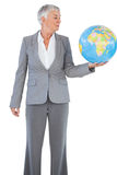 Businesswoman holding and looking at globe Royalty Free Stock Image