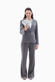 Businesswoman holding a lot of dollar bank notes Royalty Free Stock Image