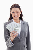 Businesswoman holding a lot of dollar bank notes Royalty Free Stock Photos