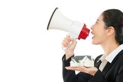 Businesswoman holding loud megaphone Stock Photo