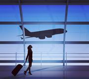 Businesswoman holding luggage Royalty Free Stock Images