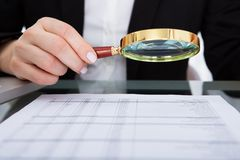 Businesswoman holding magnifying glass Royalty Free Stock Photo