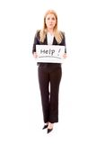 Businesswoman holding a message board with the text words Help Royalty Free Stock Photography