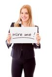 Businesswoman holding a message board with the text words Hire Royalty Free Stock Photo