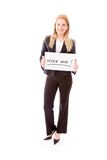 Businesswoman holding a message board with the text words Hire Stock Photo